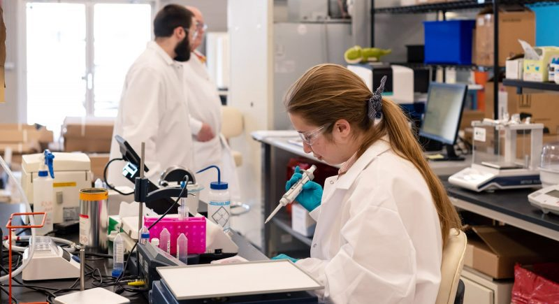 Employees at SiPhox working in the lab in Burlington, Massachusetts